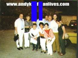 With the psychic surgery clinic in the Philippines.  The two faces blocked out are said to be the keys to the mystery -- one is Stanley, Andy's father ... the other is, in our theory, the man who actually died.  Andy is seen to the far right next to his girlfriend, Lynne.